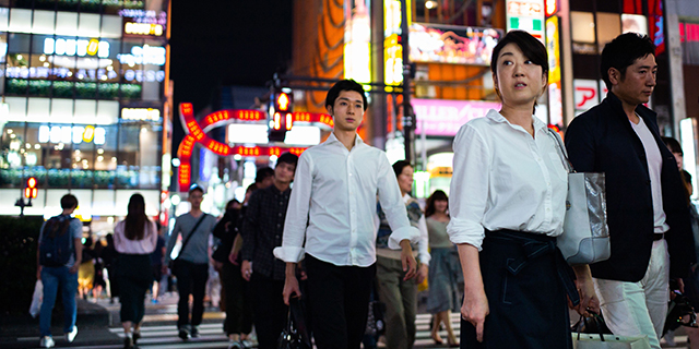 People walking in the streets of Shinjuku district of Tokyo. (Martin Bureau/AFP/Getty Images)
