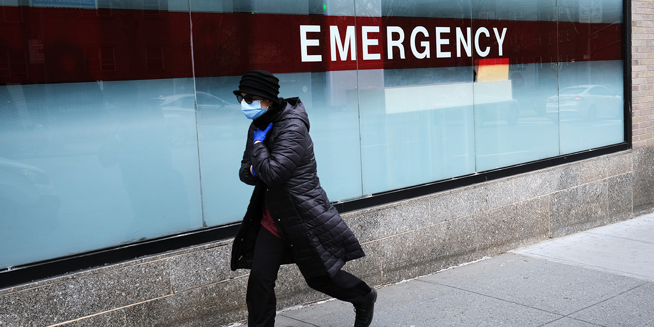 A woman walks by the emergency entrance to Mount Sinai Hospital in New York City on March 31. (Spencer Platt/Getty Images)