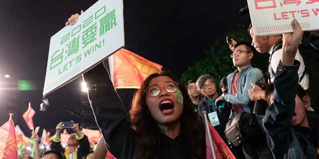 Supporters of Taiwan's Democratic Progressive Party celebrate President Tsai Ing-wen's reelection in Taipei on Jan. 11, 2020. (Yat Kai Yeung/NurPhoto via Getty Images)