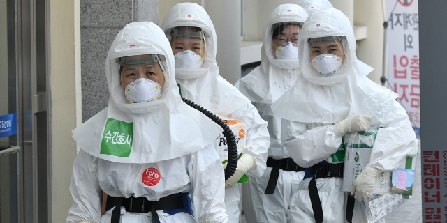 Nurses in protective gear arrive to care for patients infected with the coronavirus at Keimyung University Daegu Dongsan Hospital in Daegu, South Korea, on April 29. (Jung Yeon-je/AFP via Getty Images)