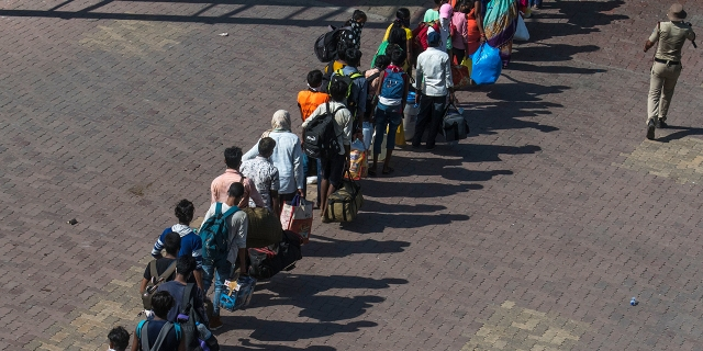 People in Mumbai wait to return by train to their respective villages across India at Lokmanya Tilak Terminus on May 30, 2020. (Pratik Chorge/Hindustan Times via Getty Images)