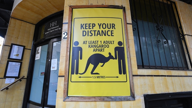 A sign outside a hotel in Sydney, Australia warning people to keep their distance. (James D. Morgan/Getty Images)