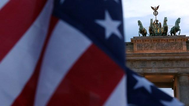Brandenburg Gate in Berlin framed in the American flag. (Adam Berry/Getty Images)