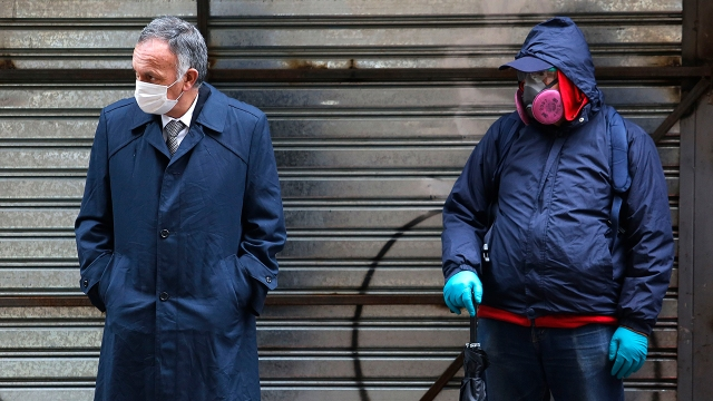 Jobless men wait to collect state bonds or loans aimed at middle-class Chileans amid a widespread coronavirus lockdown in July 2020 in Santiago. (Marcelo Hernandez/Getty Images)