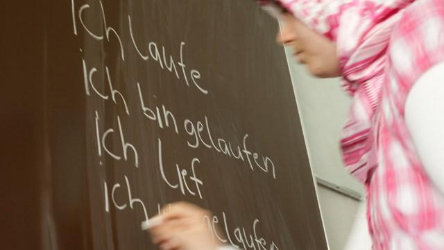 A student in Berlin conjugates a verb for class. (Scherhaufer/ullstein bild via Getty Images)