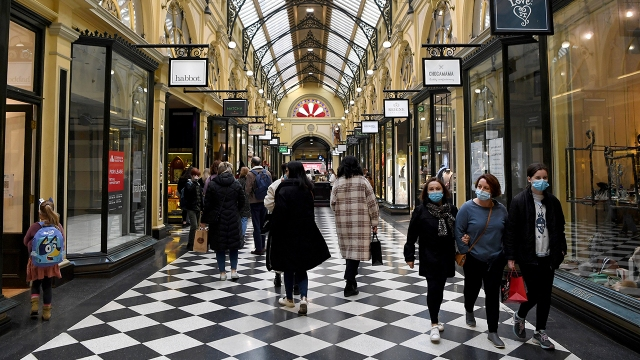 Shoppers return to the central business district in Melbourne, Australia, on July 7, 2021, after the city announced an easing of COVID-19 restrictions. (William West/AFP via Getty Images)