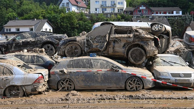 Photo showing mud-covered cars stand piled up near Bad Neuenahr-Ahrweiler in western Germany on July 22, days after deadly floods caused major damage in the region. (Christof Stache/AFP via Getty Images)