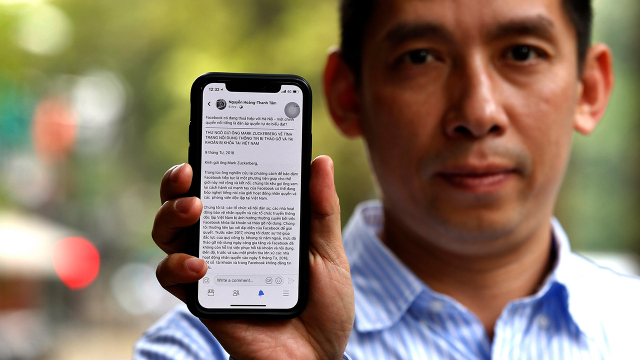 In Vietnam, about half of adults say social media are at least somewhat important for keeping up with political news and other developments. Above, Vietnamese activist La Viet Dung has alleged Facebook may be helping to suppress online dissent. (AFP/Getty Images)