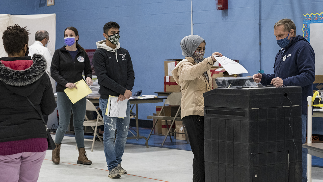 A first-time voter casts her ballot on Election Day in Manchester, New Hampshire. (Jodi Hilton/NurPhoto via Getty Images)