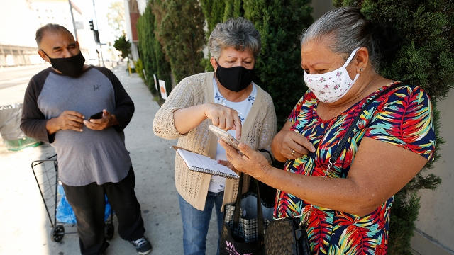Participants prepare for COVID-19 testing outside the Mexican Consulate in Los Angeles in August 2020. (Al Seib/Los Angeles Times via Getty Images)