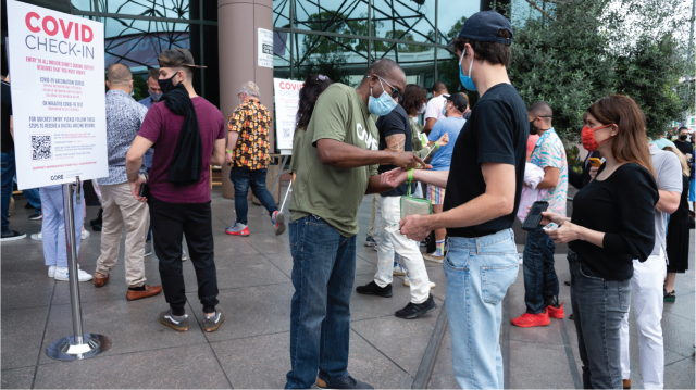 Moviegoers have their COVID-19 vaccination status checked before entering an LGBTQ film festival screening on Aug. 21, 2021, in Los Angeles. (Amanda Edwards/Getty Images)