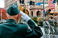 Veteran Salutes Flag During Parade