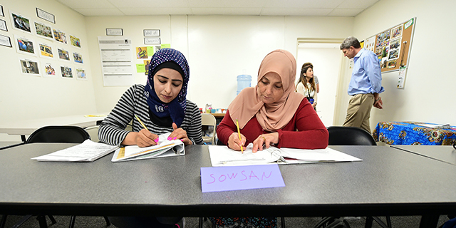 Syrian refugees take notes during their Vocational ESL class at the International Rescue Committee center in San Diego on August 31, 2016. Seated from left to right are: Rawa Hawara and Sousan Alziat. The United States has taken in10,000 Syrian refugees in 2016 as part of a resettlement program that has emerged as a hot-button issue in the US presidential campaign. / AFP / Frederic J. BROWN (Photo credit should read FREDERIC J. BROWN/AFP/Getty Images)
