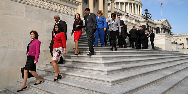Incoming members of Congress walk down the steps of the House of Representatives after posing for a group photograph Nov. 15, 2016. (Chip Somodevilla/Getty Images)