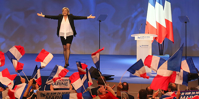 Marine Le Pen, National Front candidate for the French presidential election, addresses supporters at the start of a conference in Nantes, France, on Feb. 26. (David Vincent/AP)