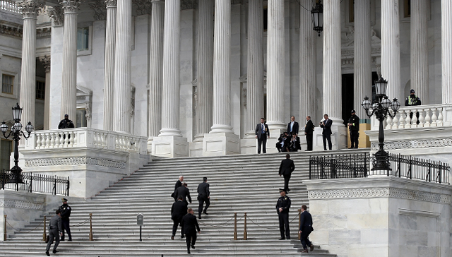 Vice President Mike Pence and his entourage arrive on the steps of the U.S. Senate to preside over Supreme Court nominee Neil Gorsuch's confirmation vote on April 7. Gorsuch was confirmed after the Senate changed its rules to permit cloture to be invoked against Supreme Court filibusters by simple majority vote. (Win McNamee/Getty Images)