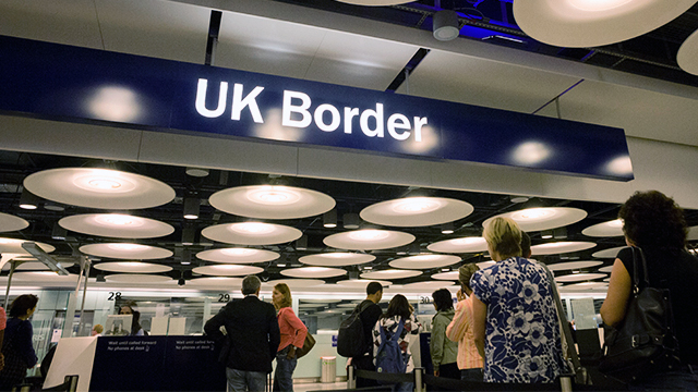 Airline passengers wait to enter the UK Border Agency's passport control area at Heathrow Airport. (Richard Baker/In Pictures via Getty Images)