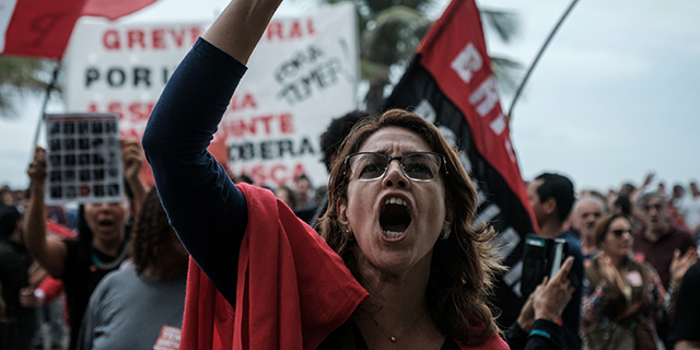 A protester shouts slogans in front of the home of Brazil's Lower House Speaker Rodrigo Maia during a protest against President Michel Temer in Rio de Janeiro on May 21, 2017. (Yasuyoshi Chiba/AFP/Getty Images)