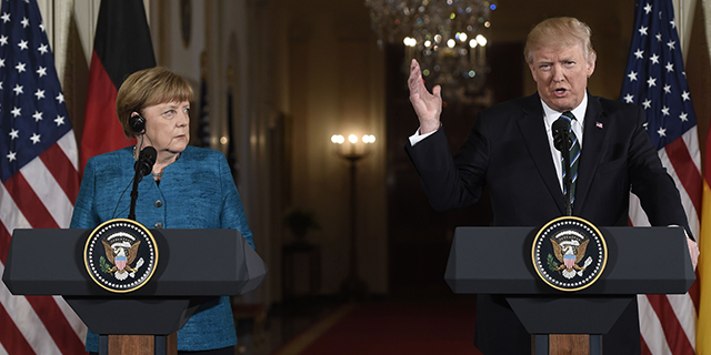 U.S. President Donald Trump and German Chancellor Angela Merkel hold a joint press conference in the East Room of the White House on March 17, 2017. (Saul Loeb/AFP/Getty Images)