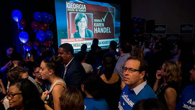 Supporters at Democratic candidate Jon Ossoff's election night watch party are stunned as CNN calls the race for Republican Karen Handel in the June 20 special election to fill the seat vacated by current Health and Human Services Secretary Tom Price. (Bill Clark/CQ Roll Call)