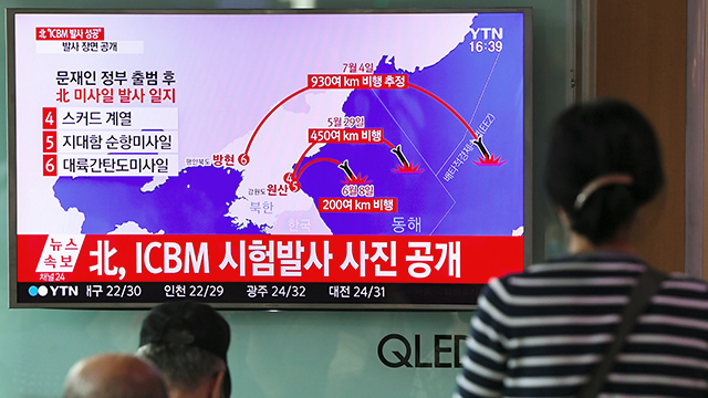 People at a railway station in Seoul watch as television news depicts North Korea's missile test on July 4. North Korea said it had successfully tested an intercontinental ballistic missile capable of hitting the United States with a nuclear weapon. (Jung Yeon-Je/AFP/Getty Images)