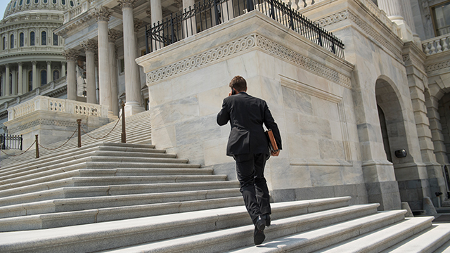 Sen. Ben Sasse, R-Neb., ascends the Capitol steps shortly before the Senate began its recess on Aug. 3, 2017. (Tom Williams/CQ Roll Call)