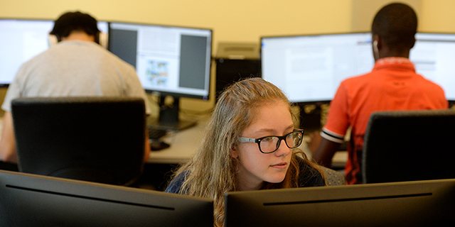 Kimber Hendrix works on a presentation on a gray water recycling system during the Summer Multicultural Engineering Training at Colorado School of Mines on July 28 in Golden, Colorado. The two-week program brings rising high school juniors and seniors from Colorado to live, learn and get a feel for college life. (Seth McConnell/The Denver Post via Getty Images)