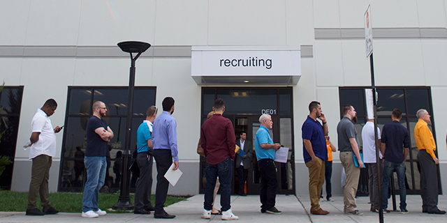 Job seekers wait in line during a jobs fair at the Amazon Fulfillment Center in Robbinsville, New Jersey, on Aug. 2. (Mark Makela/Getty Images)