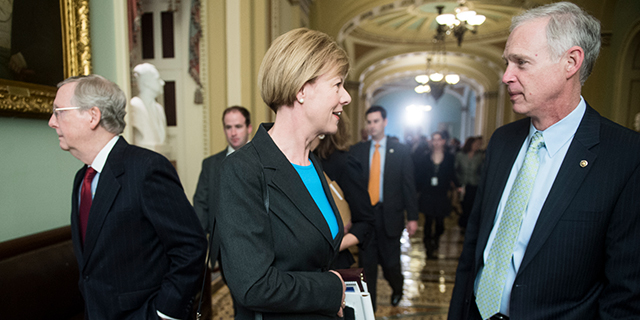 Democratic Sen.-elect Tammy Baldwin and Republican Sen. Ron Johnson, both of Wisconsin, talk in November 2012 at the Capitol as Minority Leader Mitch McConnell walks by. (Bill Clark/CQ Roll Call)
