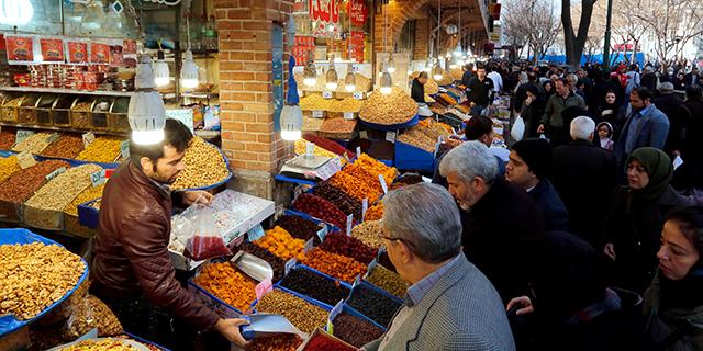 Iranians shop at Tehran's ancient Grand Bazaar on Jan. 4. (Atta Kenare/AFP/Getty Images)
