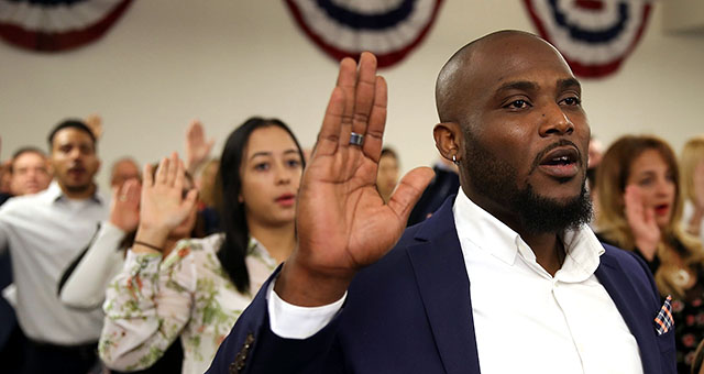 Youdelyn Momperemier, originally from Haiti, becomes an American citizen during a U.S. Citizenship and Immigration Services naturalization ceremony in Hialeah, Florida, on Jan. 12. (Joe Raedle/Getty Images)