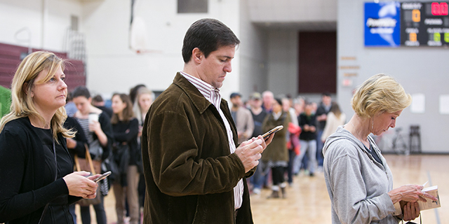 Early morning voters wait to cast their ballots on Election Day. (Jessica McGowan/Getty Images)