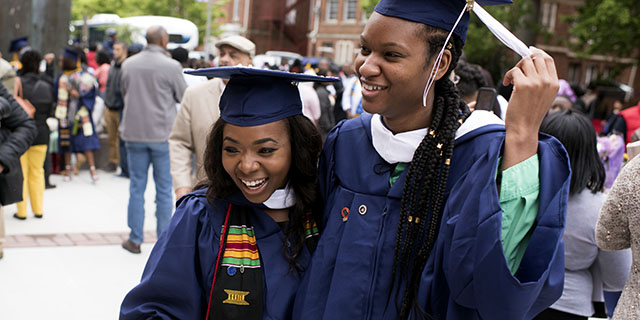 Angel C. Dye (left) celebrates her graduation from Howard University in Washington, D.C., with her friend Renee Walter on May 13, 2017. (Marvin Joseph/The Washington Post via Getty Images)