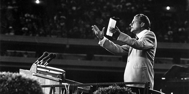 The Rev. Billy Graham preaching in 1955. (Keystone/Getty Images)