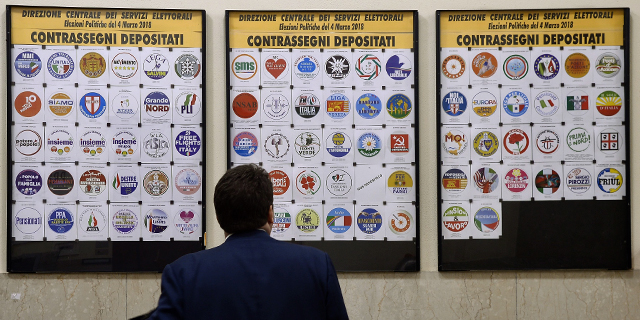 Party logos on display at Italy's Interior Ministry ahead of the March 4 general elections. (Filippo Monteforte/AFP/Getty Images)