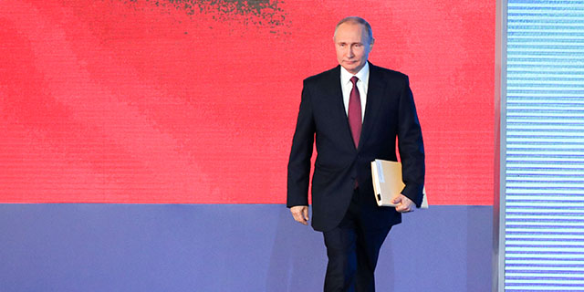 Russian President Vladimir Putin prepares to address the Federal Assembly of the Russian Federation on March 1 at Moscow's Manezh Central Exhibition Hall. (Mikhail Klimentyev/TASS via Getty Images)