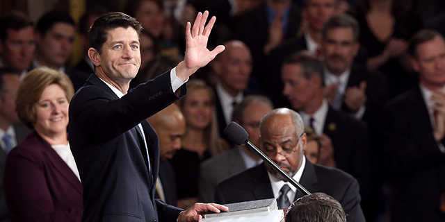 House Speaker Paul Ryan waves to colleagues at the Capitol shortly after his election to the leadership position in October 2015. (Win McNamee/Getty Images)