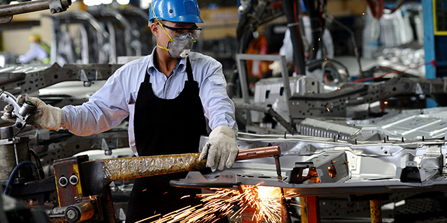 A worker welds at the Ford automotive plant in the northern province of Hai Duong, Vietnam, in January 2017. (Hoang Dinh Nam/AFP/Getty Images)