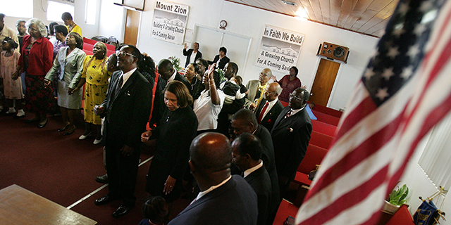Worshipers pray during services at a church in the historically black Protestant tradition in Florida in 2004. More than half of black Americans are classified as members of this tradition. (Mario Tama/Getty Images)