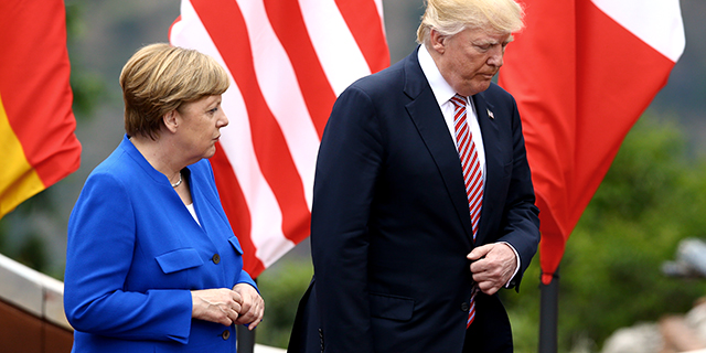 German Chancellor Angela Merkel with U.S. President Donald Trump in Taormina, Italy, on May 2017. (Photo by Matteo Ciambelli/NurPhoto via Getty Images)