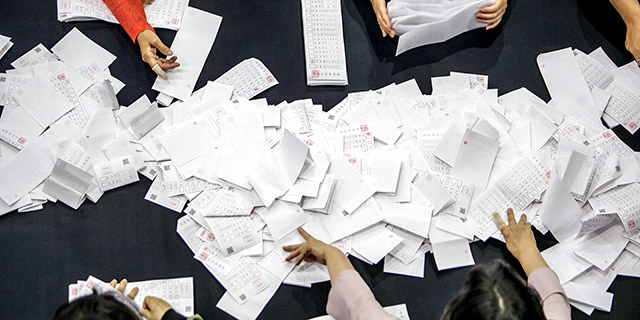 Tellers in Seoul, South Korea, count ballots from the May 2017 presidential election, which had a turnout of nearly 78% of the voting-age population. (Jean Chung/Getty Images)
