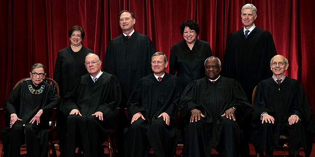Associate Justice Neil Gorsuch, top right, with the other U.S. Supreme Court justices in June 2017, several weeks after his confirmation. (Alex Wong/Getty Images)
