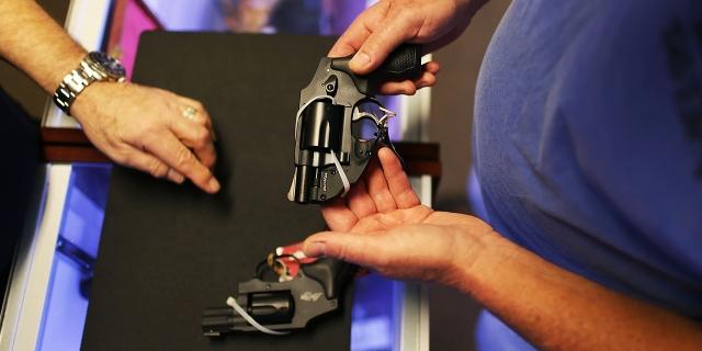 A customer shops for a handgun at a gun store in Florida.