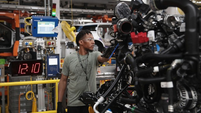 A worker assembles vehicles at Ford's Chicago Assembly Plant. (Scott Olson/Getty Images)