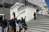 Photo of journalists shouting questions at Rep. Ron Estes as he heads into the U.S. Capitol in September.