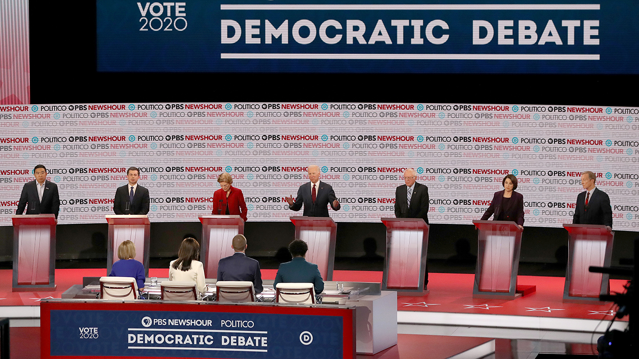 Presidential candidates on stage at the sixth Democratic primary debate. (Mario Tama/Getty Images)