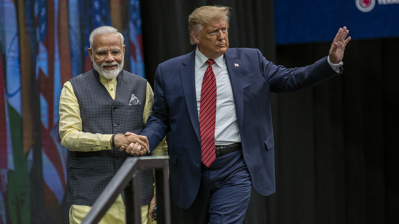 Indian Prime Minster Narendra Modi and President Donald Trump leave the stage at NRG Stadium after a rally in September 2019 in Houston, Texas. (Sergio Flores/Getty Images)