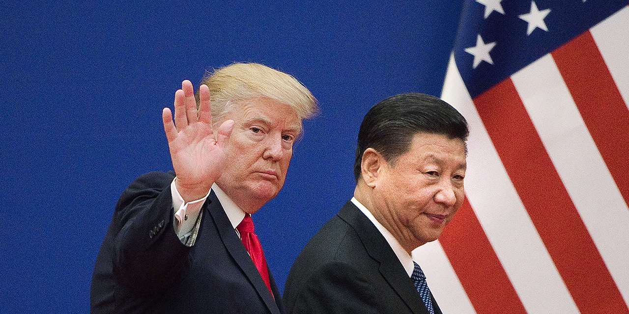 Presidents Trump and Xi leave a business leaders event at the Great Hall of the People in Beijing in November 2017. (Nicolas Asfouri/AFP via Getty Images)