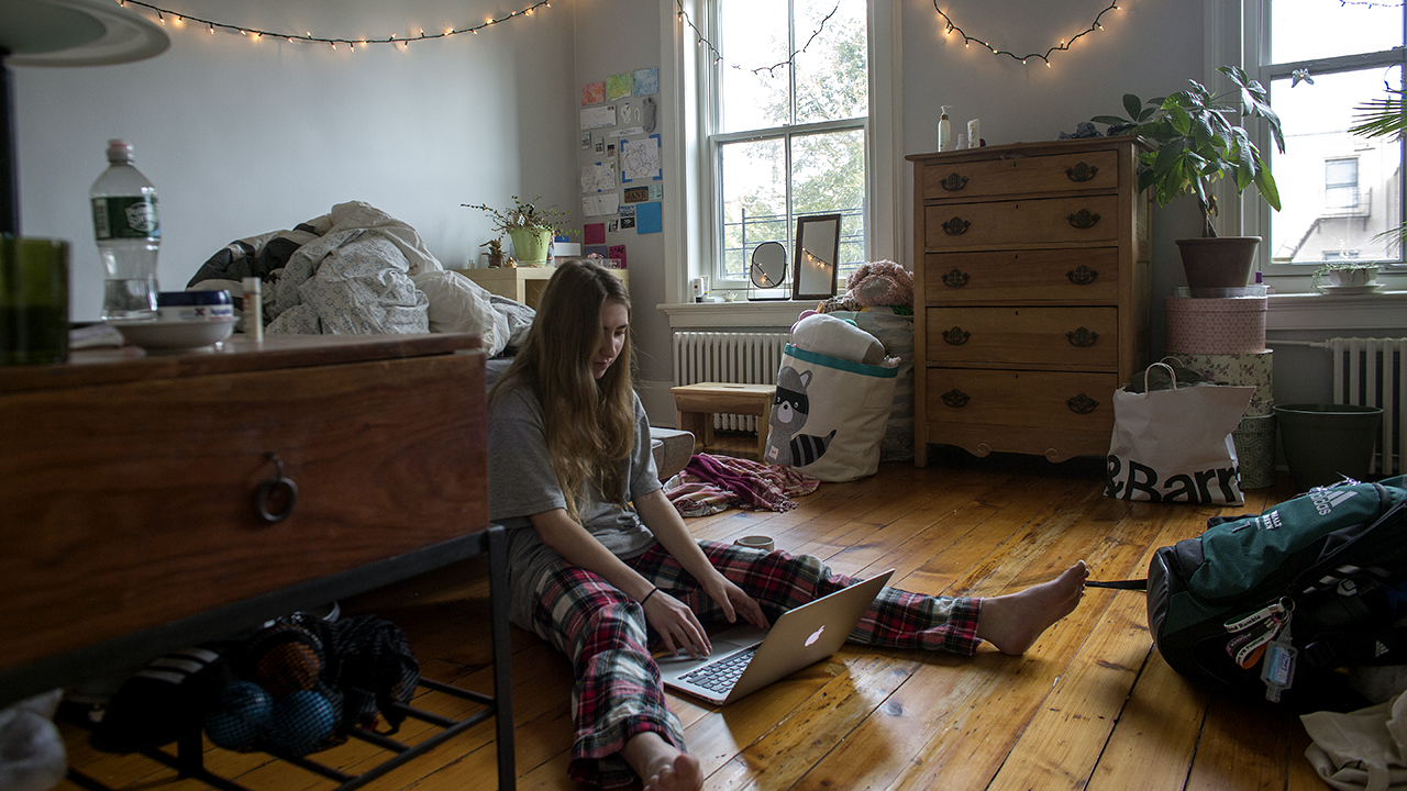 A sophomore at Brooklyn Friends School checks into her classes remotely from home after the school announced that it will be closed due to concerns about the coronavirus in Brooklyn, New York. (Andrew Lichtenstein/Corbis via Getty Images)