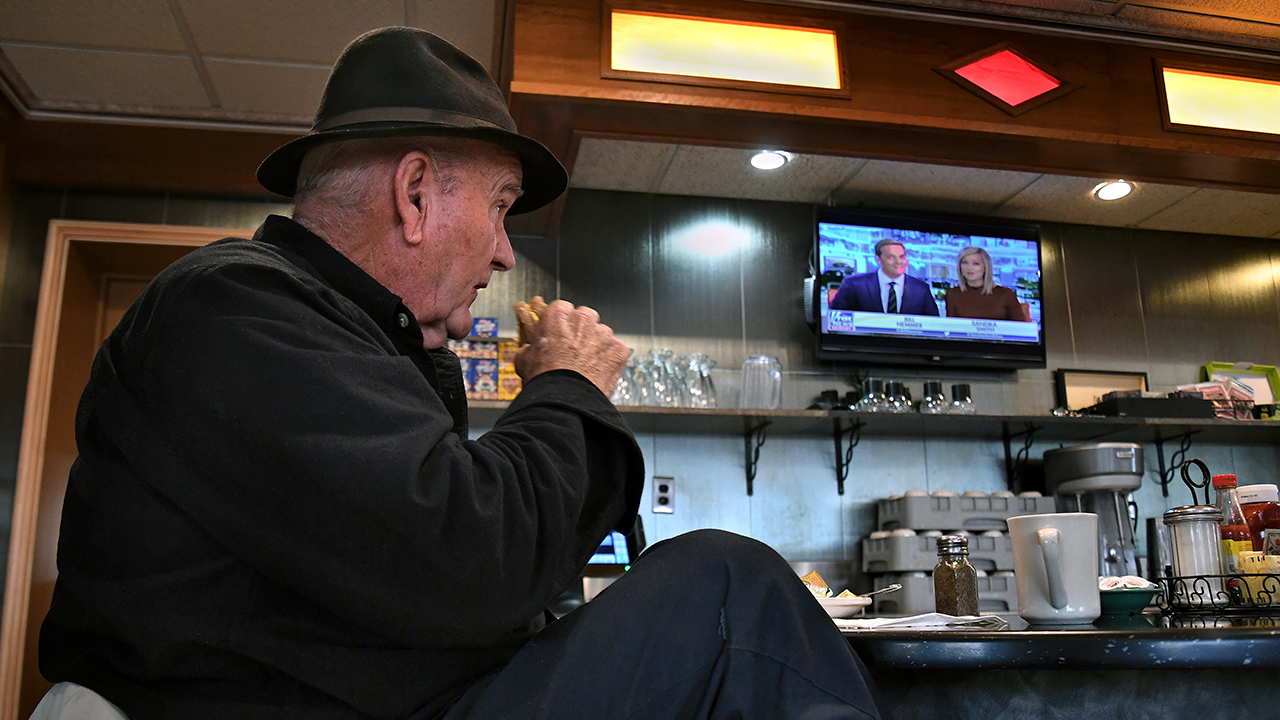 Jim Smith, a regular at Nazareth Diner in Nazareth, Pennsylvania, watches Fox News over breakfast. (Michael S. Williamson/The Washington Post via Getty Images)